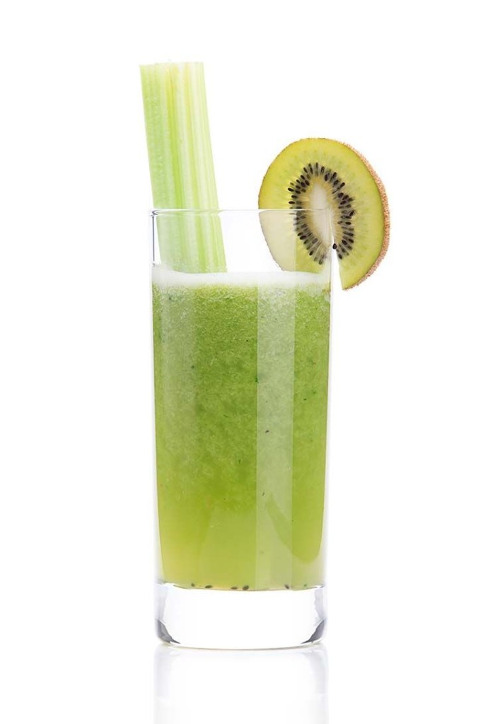 a glass of kiwi smoothie and celery